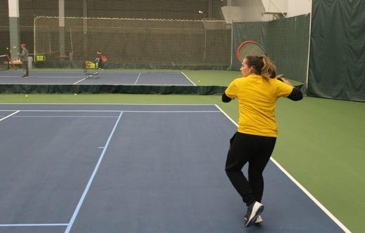Katie playing tennis